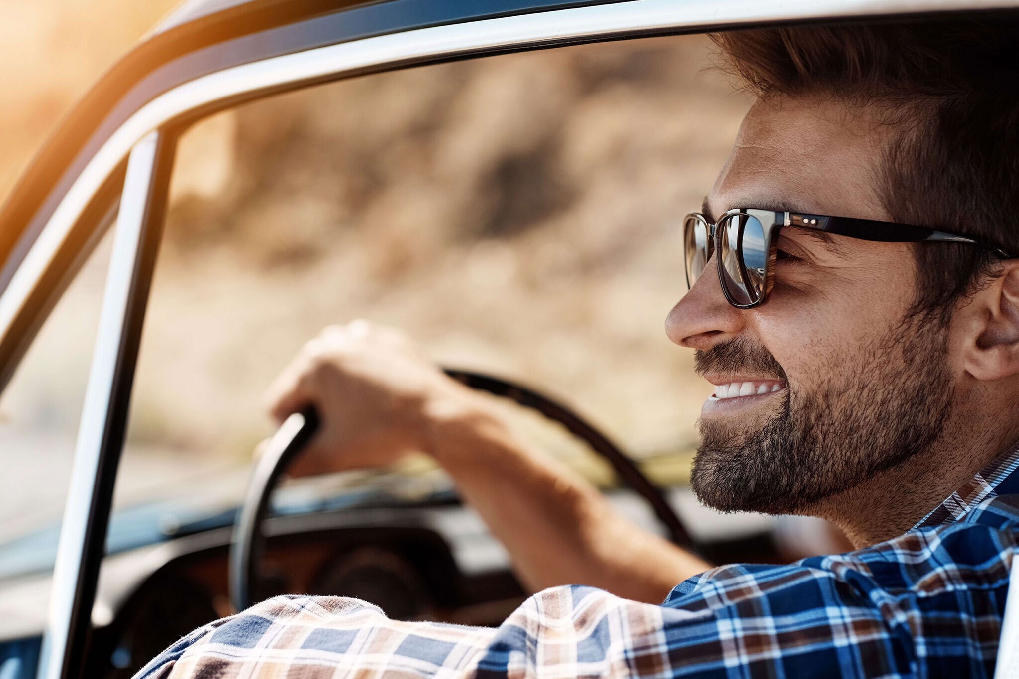 Close up of man in sunglasses driving