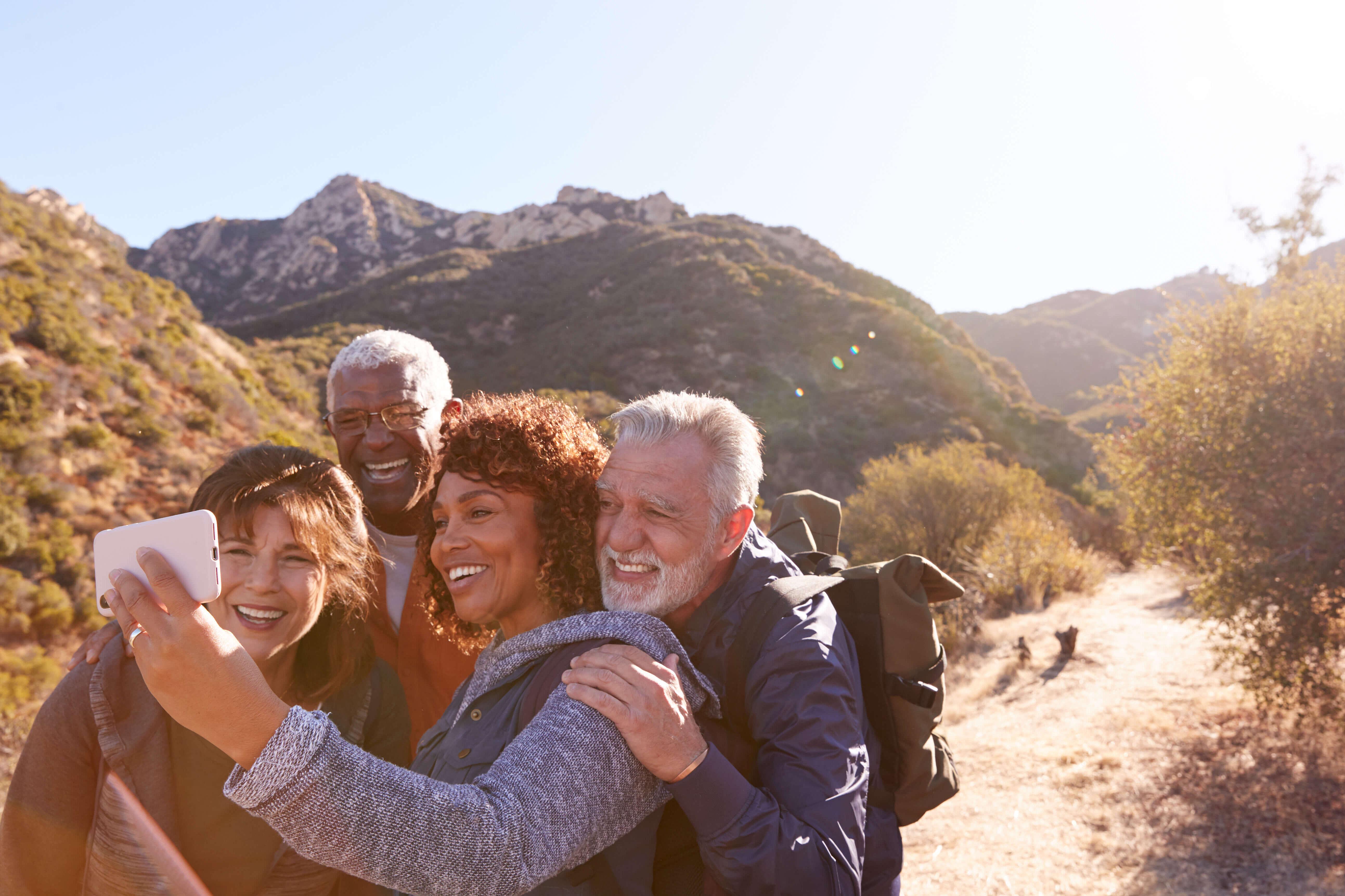 Group of older friends hiking together