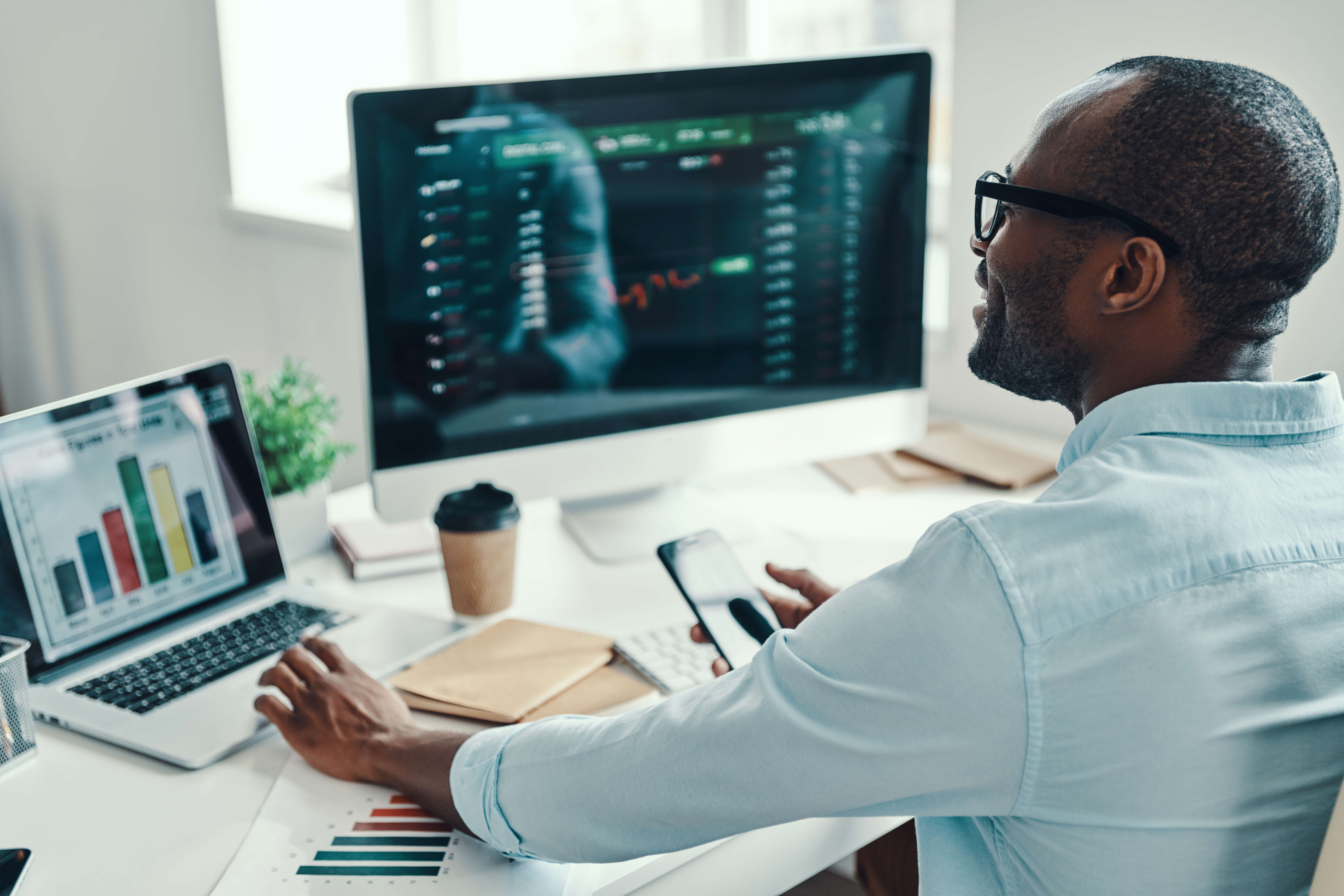Man reviewing stock portfolio on his computer 1