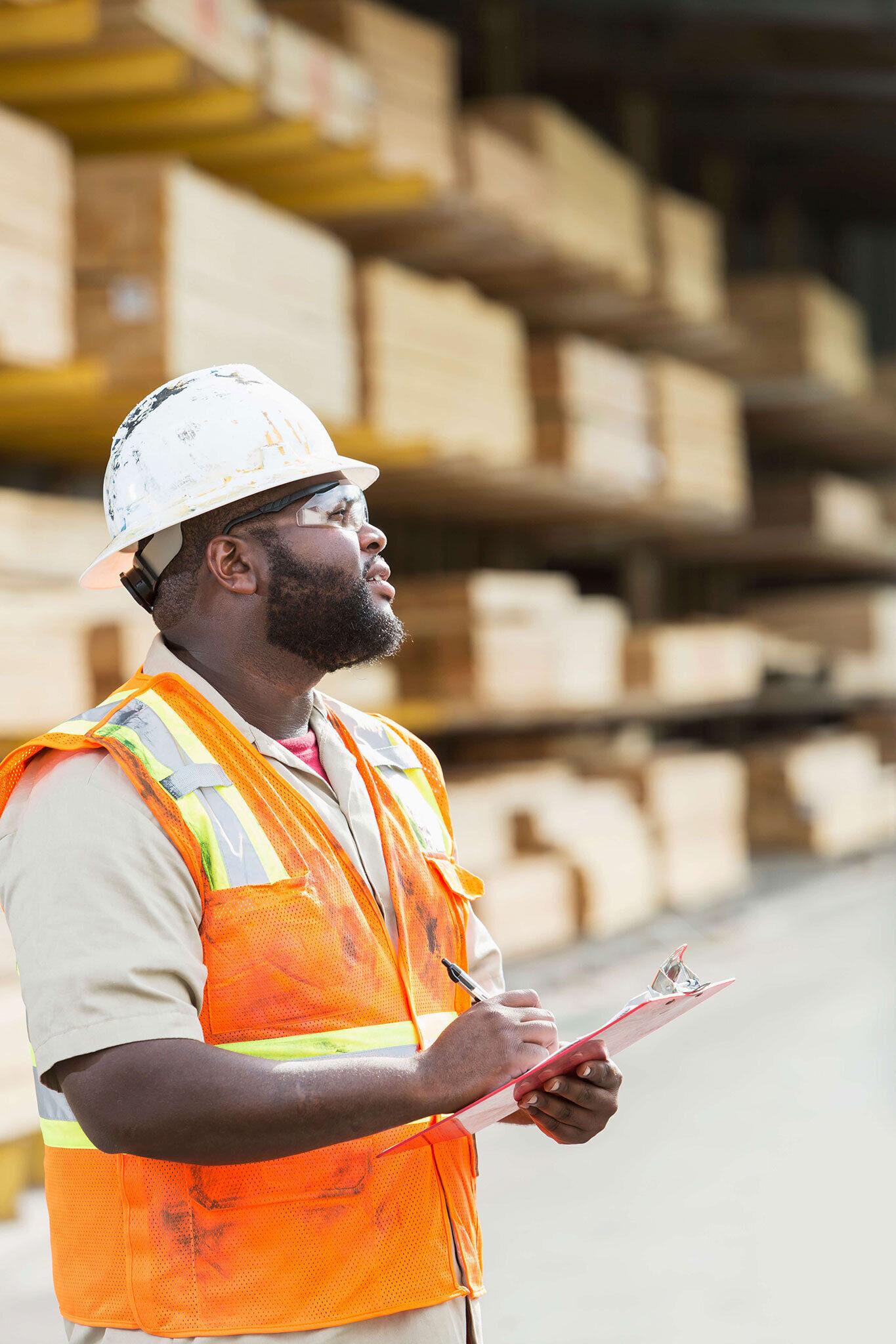 Manager wearing hard hat and orange vest