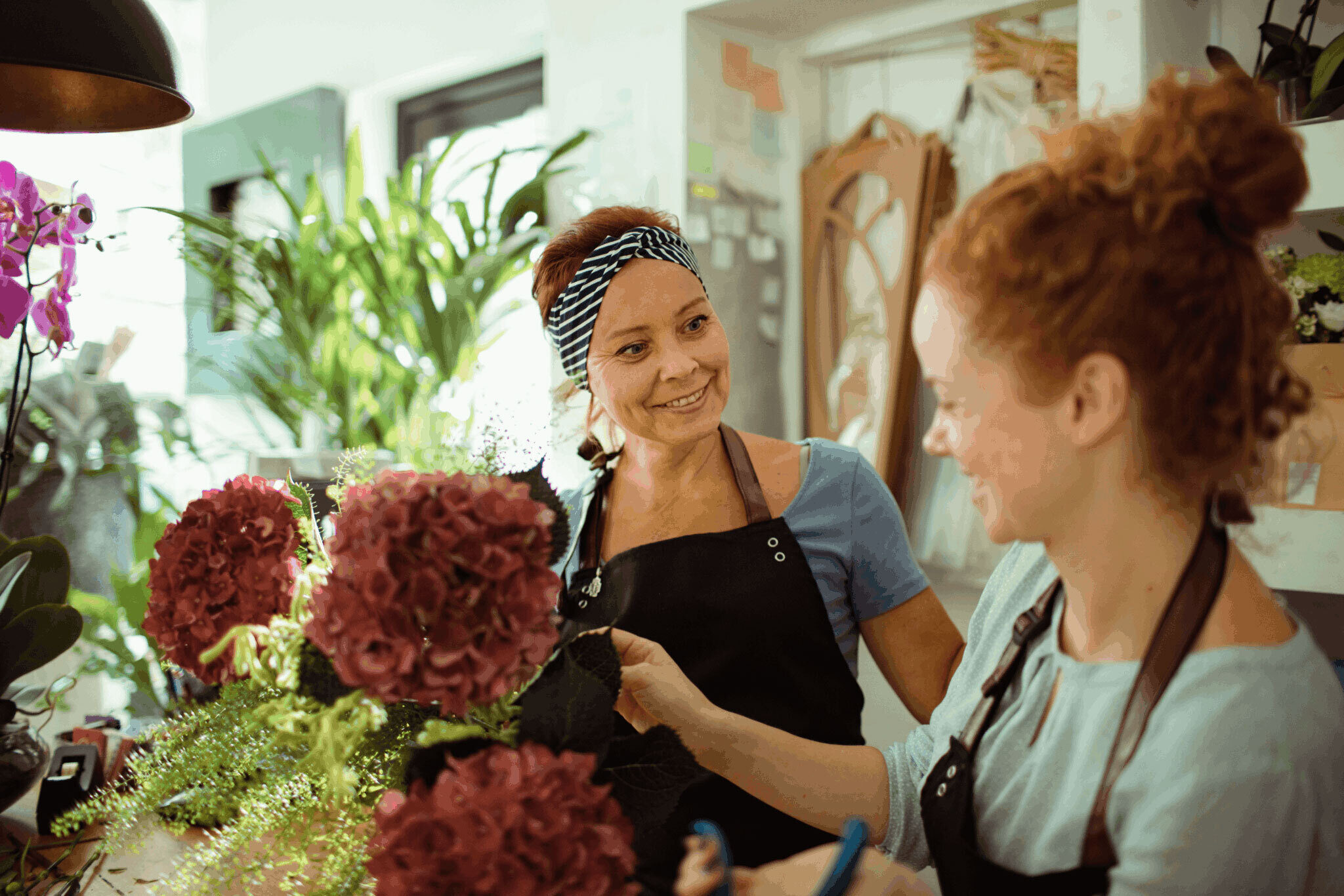 Two women working at a flower shop