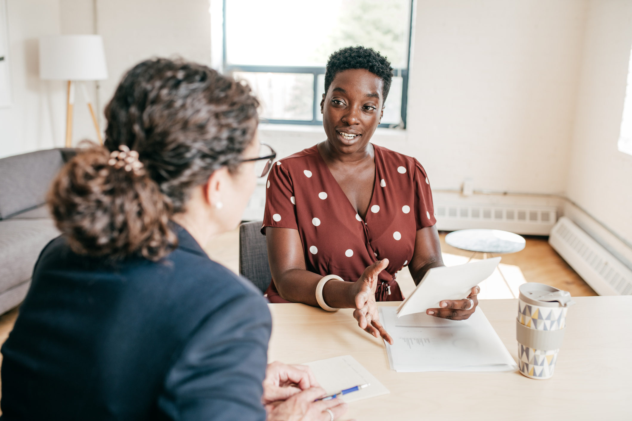 Woman having appointment with financial advisor
