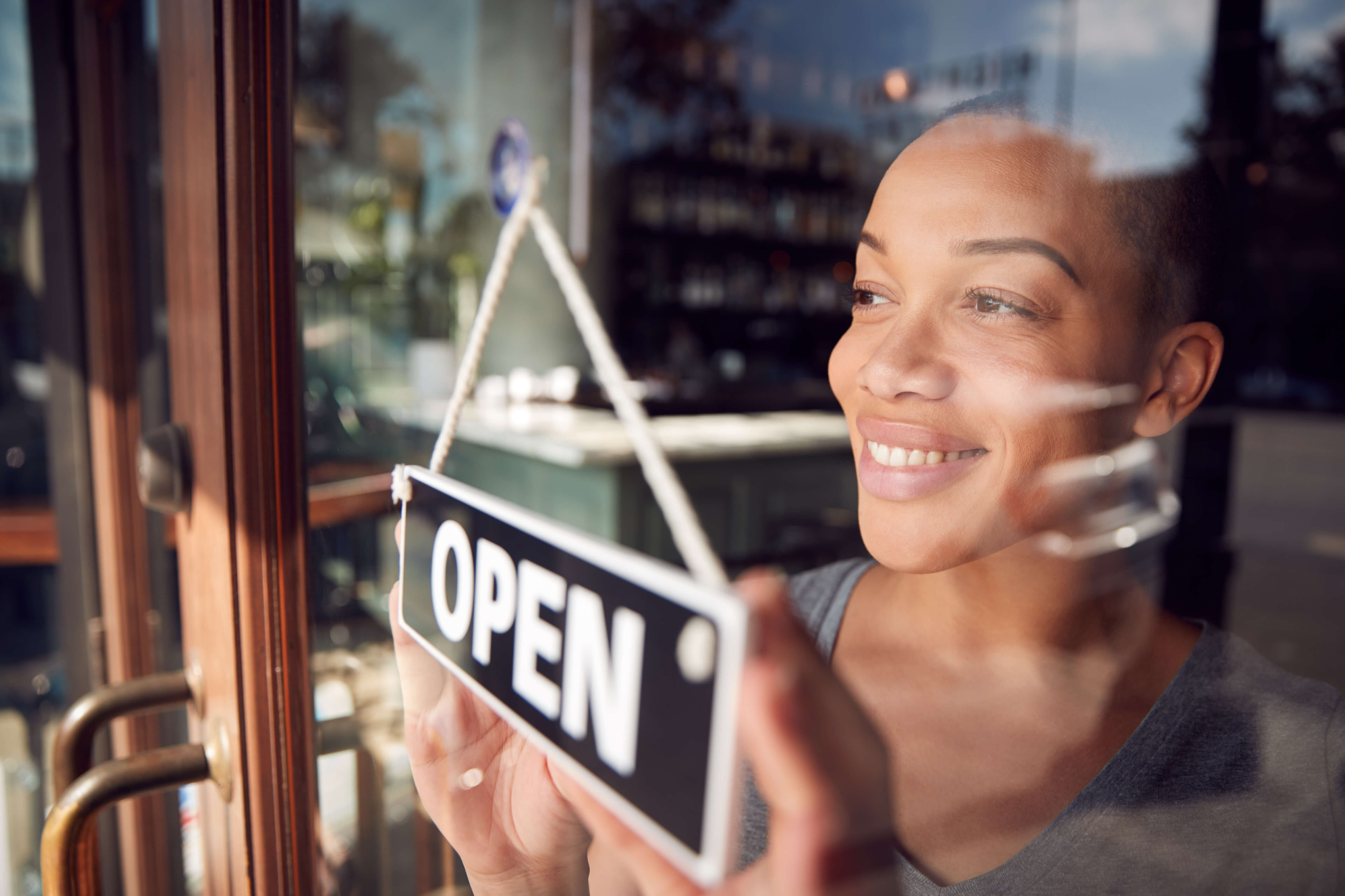 Woman opening her small business
