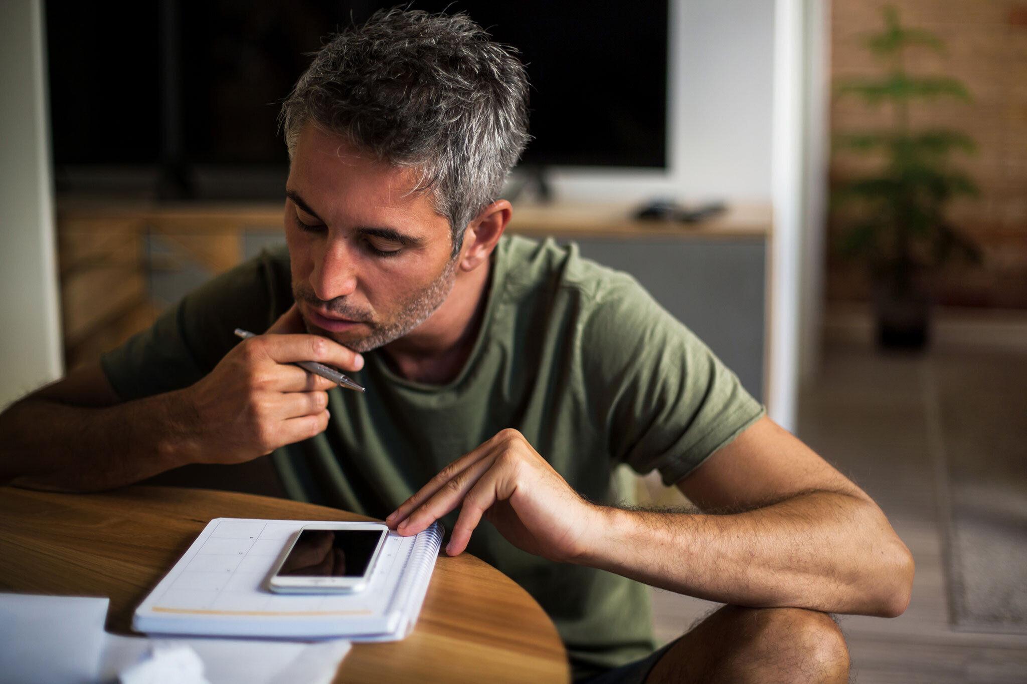 Man viewing bills